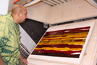 Day 3 of glass fusing and slumping course Abhai Pandaya inspects his wall panel